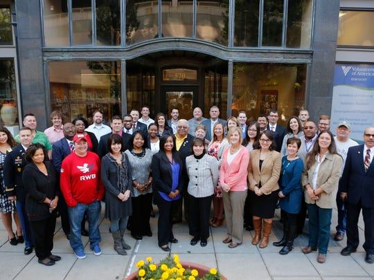 Members of the Veterans Community Alliance posed for a portrait outside of the Volunteers of America building, after a group meeting. Oct. 21, 2015.