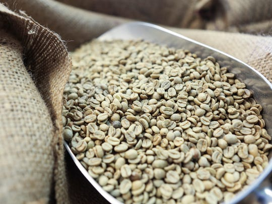 Coffee beans before being roasted at Red Hot Roasters at the corner of Lexington Road and Payne Street. Oct. 29, 2015
