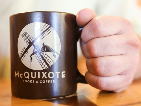 A McQuixote Coffee mug inside the coffee house that shares a space with the Tim Faulkner Gallery in Louisville's Portland neighborhood. Oct. 29, 2015