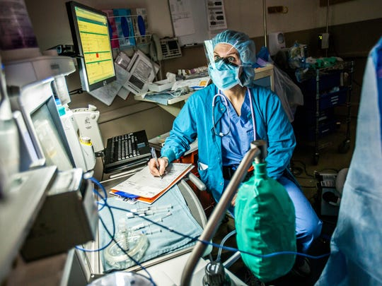 In a 2015 photo, Dana Malek, CRNA, monitors a patient's anesthesia during a surgery at Christiana SurgiCenter.