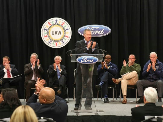 Ford President of the Americas Joe Hindrichs applauds after making the announcement of 2,000 new jobs and a $1.3 billion investment in the Kentucky Truck Plant on Dec. 1, 2015.