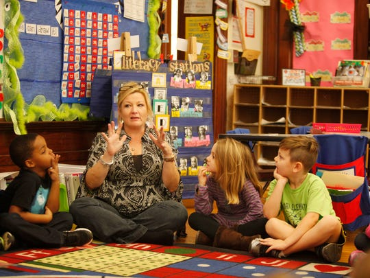 Bloom Elemenatary kindergarten instructor Treva Werner reminder her kids that they can count the number of syllables in a word by using their fingers.