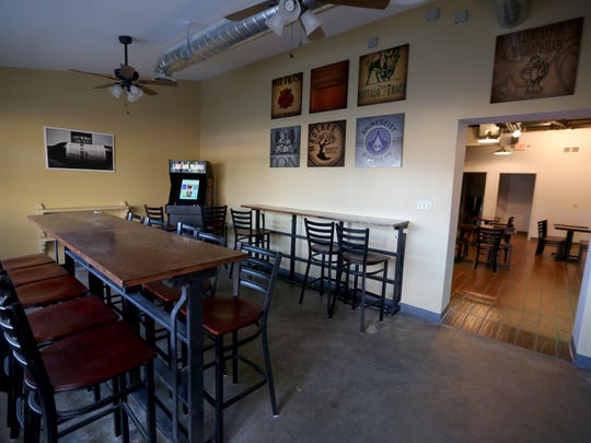 Game room area of Lucky Turtle, a new bourbon and craft beer bar in Finneytown. Photo shot Thursday December 17, 2015.