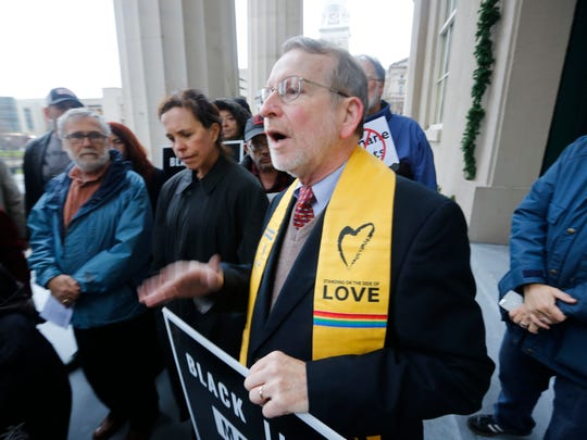 Rev. Elwood Sturtevant of the Thomas Jefferson Unitarian Church spoke out against the proposed methane plant in west Louisville on the steps of Metro Hall. Sturtevant and other protesters delivered a letter to Mayor Greg Fischer stating their opposition to the plant. Dec. 21, 2015.