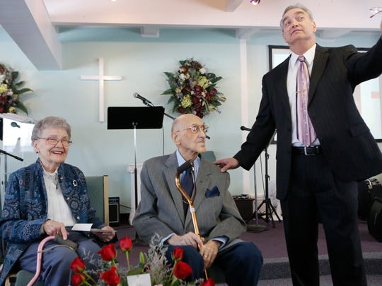 Rev. George Rye, right, pastor of the Emmanuel Assembly of God, took time during a Sunday service to honor Phil and Aileen Parrino, who are celebrating their 70th wedding anniversary.  Jan. 24, 2016.