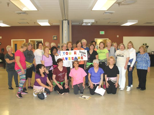 Women at Mesquite's Senior Center presented Senior Services Supervisor Griseyda Belalcazar with an award for her efforts in keeping them in shape and exercising.