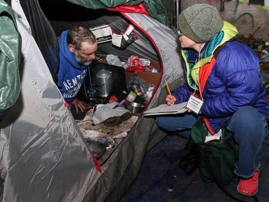 Libbie Gonce gets information from Tony, a homeless