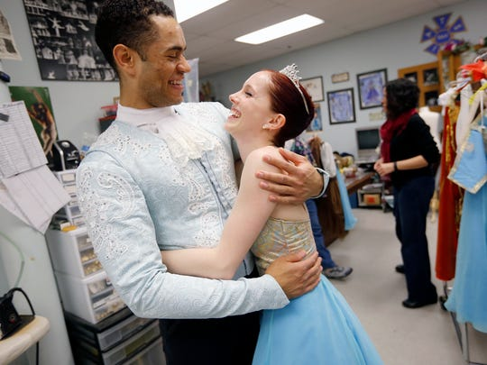 Cincinnati ballet dancers James Gilmer and Abigail Morwood smile after trying on their costumes for a dress rehearsal of Cinderella with the Cincinnati Ballet  Thursday February 4, 2016. Morwood plays the role of Cinderella and Gilmer plays the prince. Performances of Cinderella will be February 12 - 14 at the Aronoff Center for the Arts.