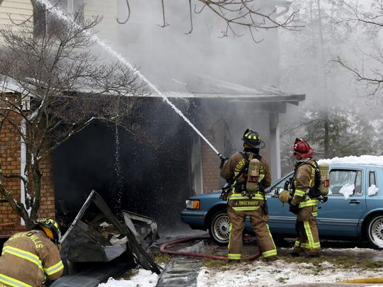 Greenhills and Forest Park Fire Departments assist with putting out a house fire on Timbermill Court in Springfield Township Monday February 15, 2016. One man was found dead.