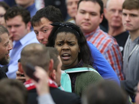 Shiya Nwanguma, a University of Louisville student, is seen being removed from a Donald Trump rally in Louisville. March 1, 2016