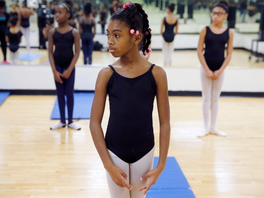Kamaria Black, 10, of Cincinnati, learns first position during practice with Princesses Ballet at  the Carl Lindner YMCA .
