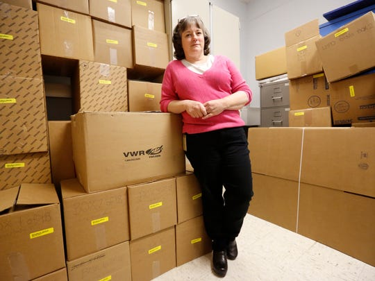 Laura Sudkamp, director of the Kentucky State Police Forensic Lab, is surrounded by boxes filled with 1,187 rape kits waiting to be shipped for testing at other labs. Grant money his helping to ease the logjam of untested kits.