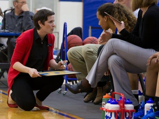 Mercersburg Academy coach Katie LaRue, left, has Michigan