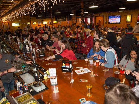 Guests watch Iowa State play Saturday, March 19, 2016, during an NCAA tournament watch party at Buzzard Billy's in Des Moines.