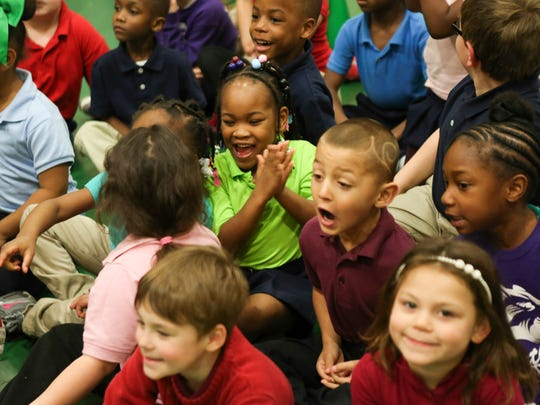 """Portland Elementary students listen during an announcement about the new college fund for Portland Elementary students called """"Louisville Goes to College."""" Students will be getting $100 put into a college fund for them every year from kindergarten until high school graduation. March 28, 2016"""