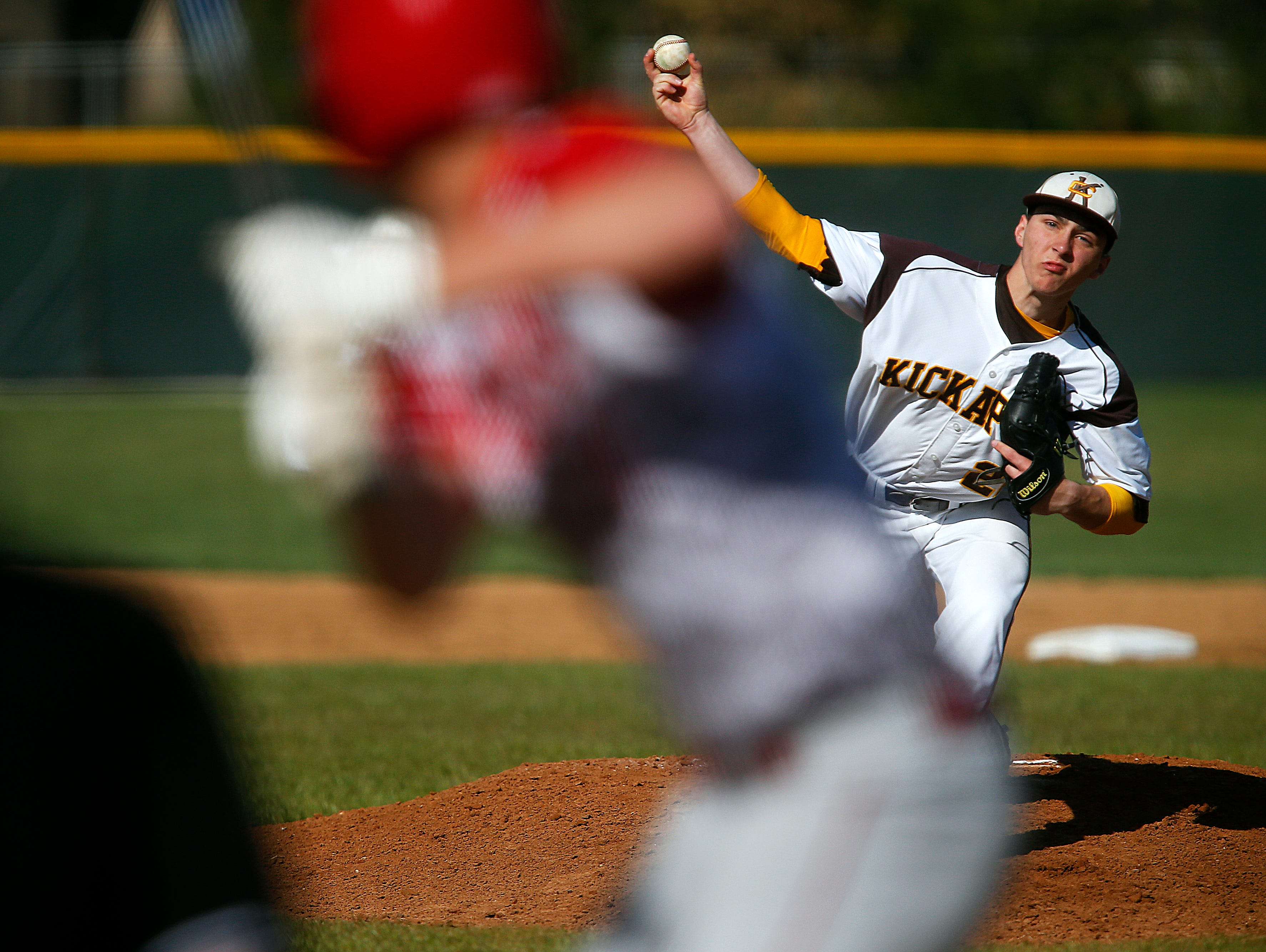 Kickapoo High School pitcher Kaleb Schmidt (22) pitches during first inning action of the high school baseball game between Kickapoo and Ozark at Kickapoo High School in Springfield, Mo. on March 29, 2016.