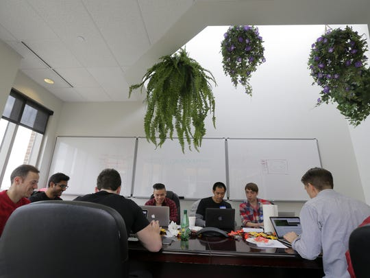 Rutgers Coding Bootcamp students participate in the Hackathon at V12 Group in Red Bank on April 8.
