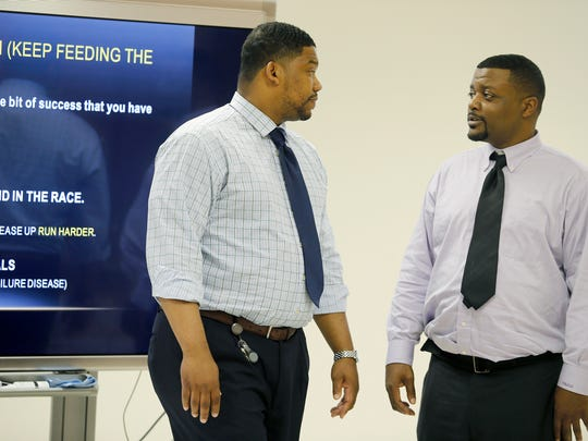Walker (left) talks with student Shawn Nelson during a recent SOAR class.