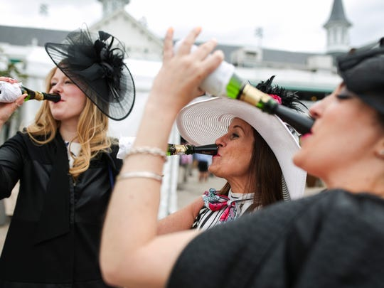 Katie Mathews, from left, Kelly Scherer and Rayanne Peplinski enjoy champagne Thursday at Thurby.