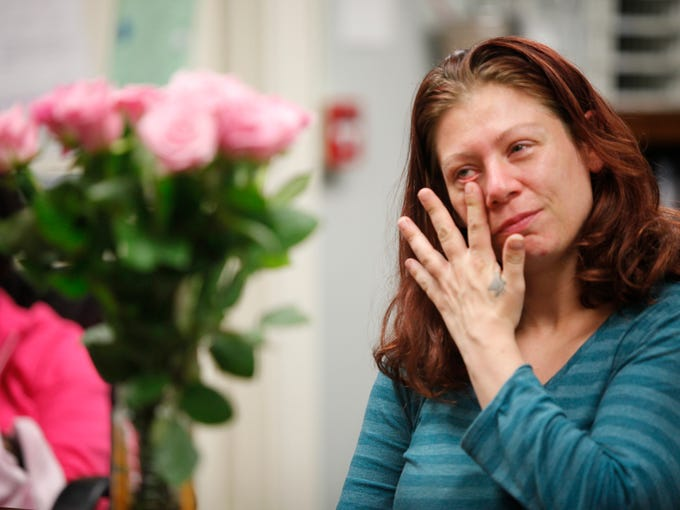Kymball Pruett wipes away a tear as she was honored