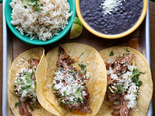 The Barbacoa Tacos with a side of black beans and rice at Doc's Cantina. May 10, 2016