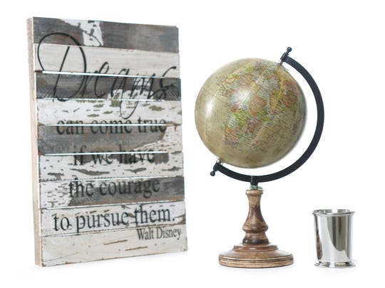 Give some inspiration and tradition: Sweet Bird & Co sign, $29.99; and Home Essentials globe, $24.99; both at Steinmart. Silver julep cup, $85, at Claters jewelers.