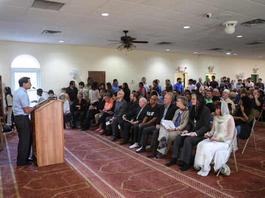 Attendees look on at the Louisville Islamic Center