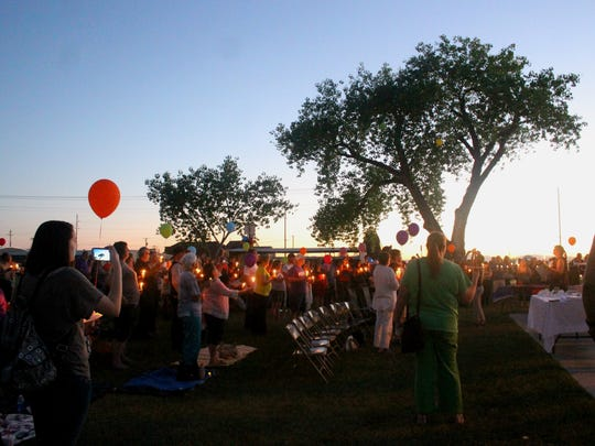 Balloons are released as each name of the 49 victims are read throughout the crowd in Alameda Park.