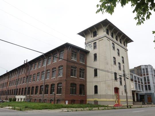Outside of the Bradford Mills building along East Oak