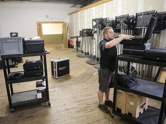 C&H Audio and Visual Services employee Buddy Shirey unpacks equipment inside the company's staging space at the Hope Worsted Mills Co. building located at 942 East Kentucky Street. C&H began renting space in the former mill in 2000 and has expanded from small offices to using 13,000 sq ft of space. June 27, 2016