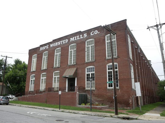 Outside of the Hope Worsted Mills Co. building located at 942 East Kentucky Street that is currently used by artists and commercial businesses. June 27, 2016