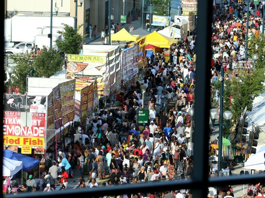 "Freedom Way at Elm Street is packed with vendors and people for the Cincinnati Music Festival at Paul Brown Stadium Friday July 22, 2016.Friday's line up also included The Whispers, Fantasia, Kenny ""Babyface"" Edmonds, New Edition. The annual two-day event started in 1962."