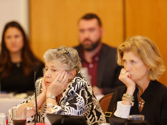 Members of the ousted University of Louisville board of trustees, Marie Abrams, left, and Emily Bingham, listened during one of various updates to the board. Aug. 25, 2016.