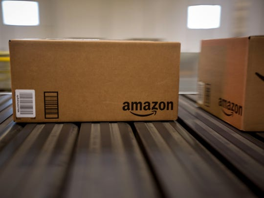 Boxes move along a conveyor belt at the Amazon.com Inc. fulfillment center in Robbinsville, New Jersey.
