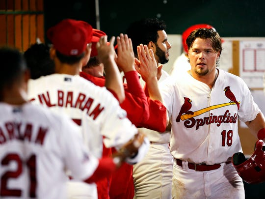 Springfield Cardinals first baseman Luke Voit (18) celebrates with his teammates in the dugout after scoring a run during first inning action of the Texas League playoff game between the Springfield Cardinals and the Northwest Arkansas Naturals at Hammons FIeld in Springfield, Mo. on Sept. 8, 2016.