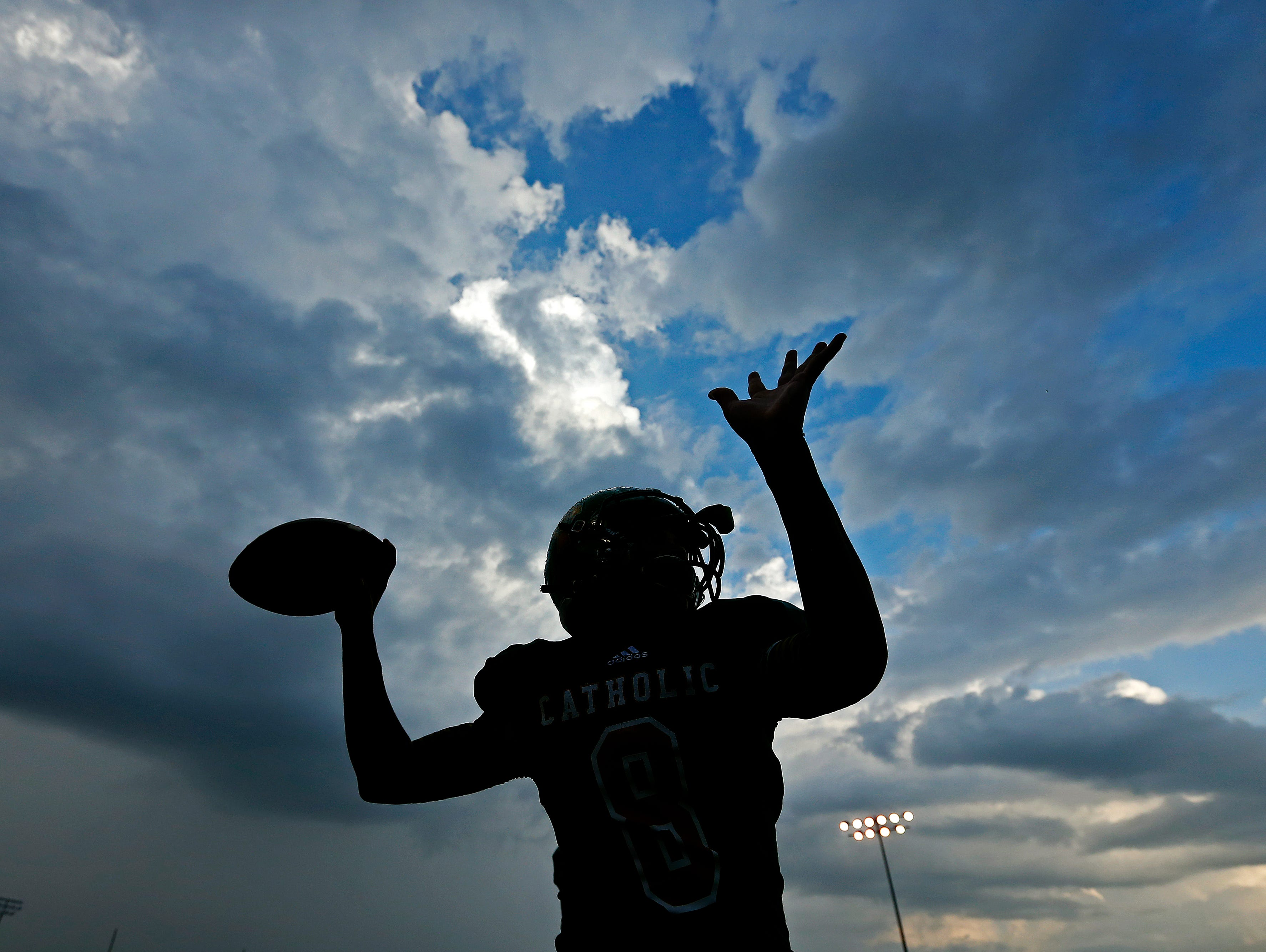 Springfield Catholic quarterback Tyson Riley (8) warms up prior to the scheduled game between Springfield Catholic High School and Fair Grove High School at Springfield Catholic High School in Springfield, Mo. on Sept. 9, 2016. The game was postponed due to severe weather in the area.