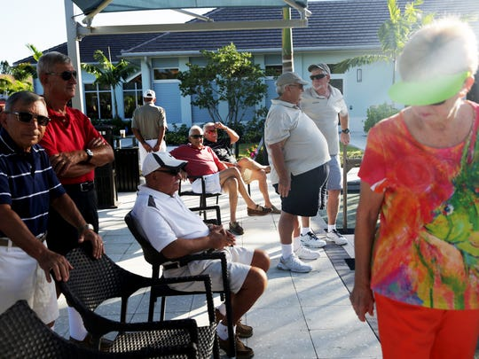 Spectators and competitors sit along the sidelines during a bocce ball competition at Bentley Village in Naples on Friday, Oct. 14, 2016.