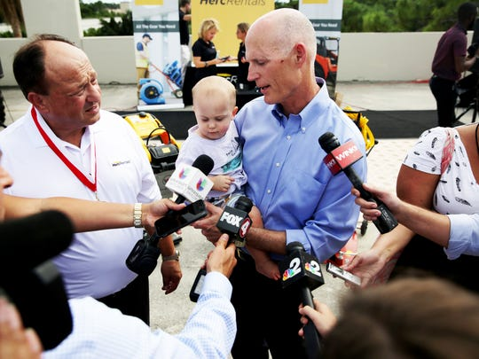 Herc Rentals President & Chief Executive Officer Larry Silber, left, and Gov. Rick Scott answer questions during Scott's visit to Herc Rentals in Bonita Springs on Thursday, Oct. 20, 2016.