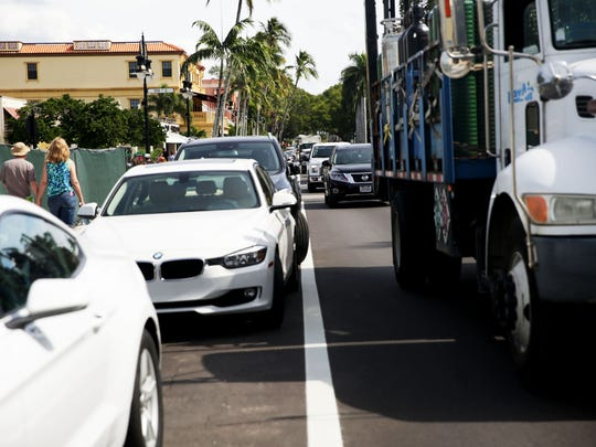 Traffic backed up along 5th Ave South in downtown Naples on Tuesday, Oct. 25, 2016.