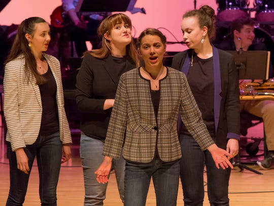 Magalia members Emma Maurer (front row) and (back row) Mira Vance, Clare Liss, and Jenny Bell perform at Mercersburg Academy's Spring Pops Concert.
