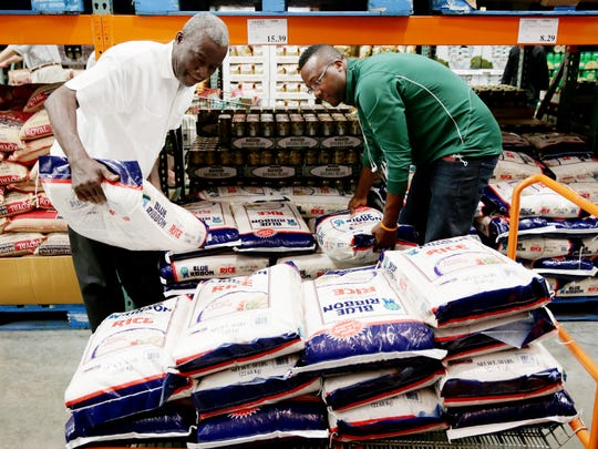 Bayshore Education Center Executive Director Matt Paul, right, and his father, Pastor Gene R. Paul, shop for rice at Costco in Naples on Wednesday, Nov. 9, 2016. Timeless Worth Coaching and Consulting LLC and Bayshore Education Center are teaming up to send food and supplies to Haiti through Naples New Haitian Church of The Nazarene.