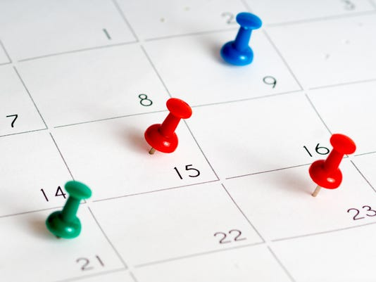 green red blue pins on calendar grid