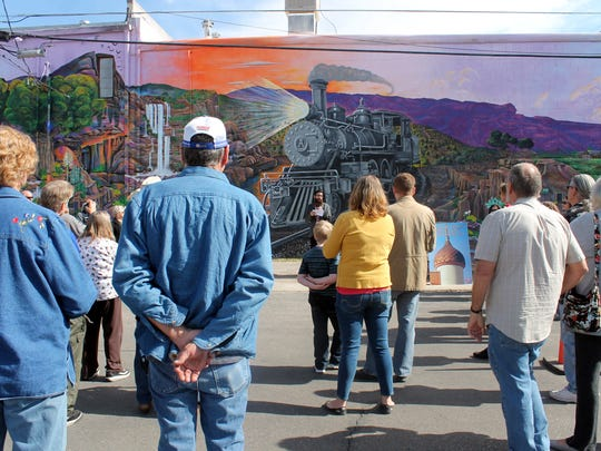Several community members gathered in front of the mural on Thursday morning to attend the dedication ceremony.