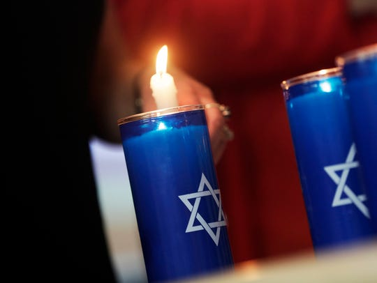 Six candles are lit in memory of the six million jews