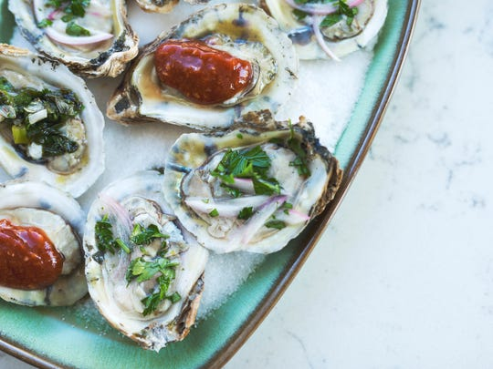 Oysters on the half shell with holiday sauce trio.