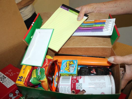 Each shoebox is packed with small toys, candy, school supplies and non-liquid hygiene items.
