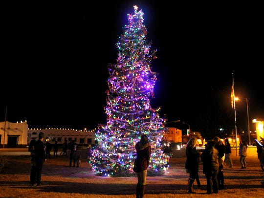 Residents enjoy the lit tree outside of the Alameda Park Zoo during the city's annual tree lighting ceremony.