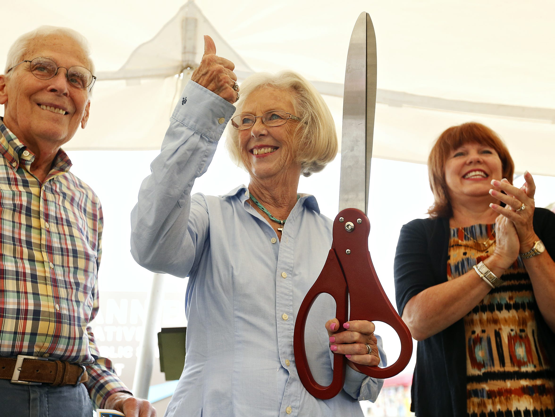 Roseann Bentley smiles after cutting the ribbon to