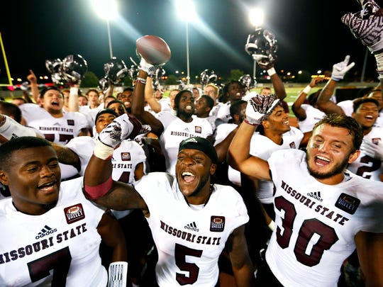 Missouri State Bears safety Tre Betts (7), wide receiver Deion Holliman (5) and safety Jared Beshore (30) celebrate with their teammates celebrate after the conclusion of the NCAA football game between the Missouri State Bears and Murray State Racers held at Roy Stewart Stadium in Murray, Ky. on Sept. 10, 2016. The Bears won the game 28-22.