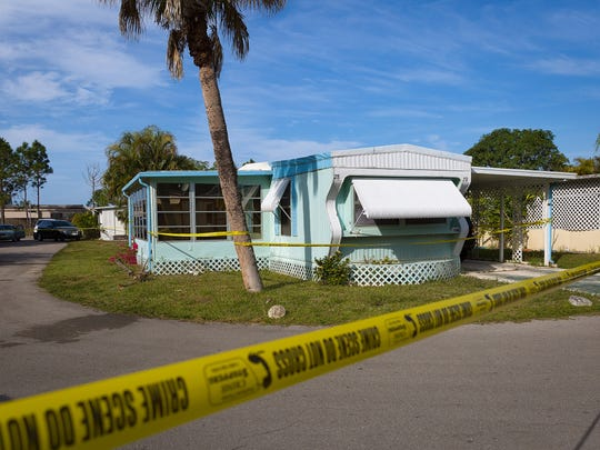 A home in the Sunny Acres mobile home park in East Naples sits taped off by Collier County Sheriff's Office during a death investigation on Monday, Dec. 12, 2016.